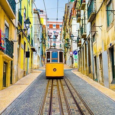 experience life as a local group up the hills with a train in Lisbon