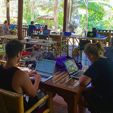 cowork with other digital nomads at kohub, tropical coworking space in the island of koh lanta.